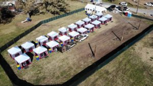 Aerial view of campground and tents.